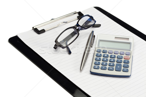 Angled note pad, pen, glasses and pocket calculator on a white background Stock photo © wavebreak_media