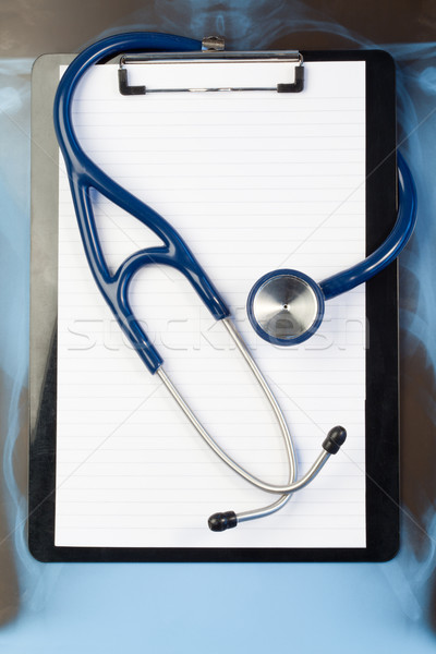 Note pad and stethoscope on a blue and dark background Stock photo © wavebreak_media