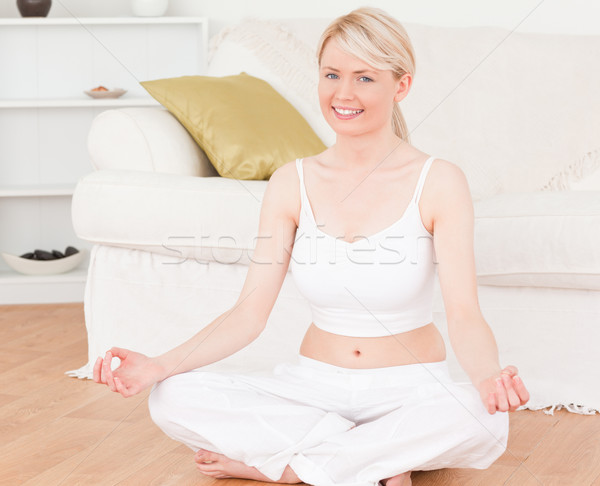 Young female doing yoga in the living room in her appartement Stock photo © wavebreak_media