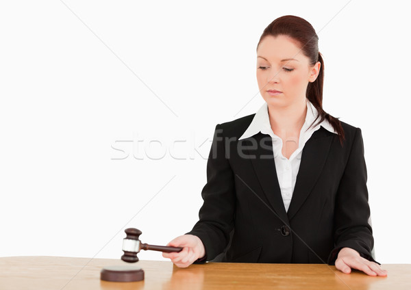 Young judge knocking a gavel against a white background Stock photo © wavebreak_media