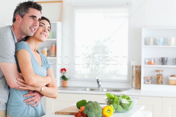 Man and woman hugging in a kitchen Stock photo © wavebreak_media