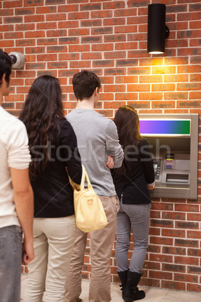 Portrait of people queuing to withdraw cash at an ATM Stock photo © wavebreak_media