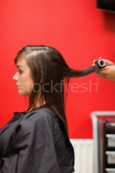 Portrait of hands rolling hair with a curler Stock photo © wavebreak_media