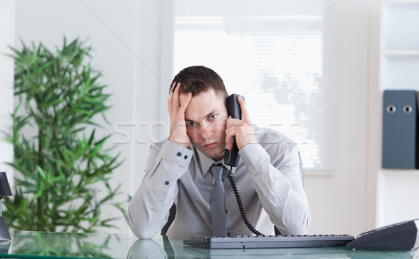 Depressed businessman getting disappointing news on the phone Stock photo © wavebreak_media