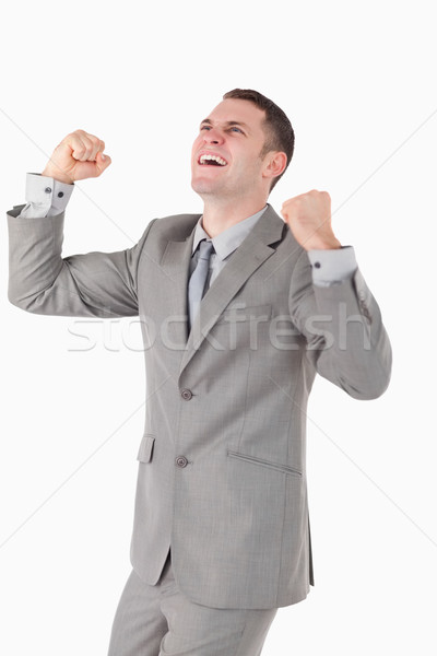 Portrait of a businessman with his fists up against a white background Stock photo © wavebreak_media