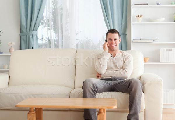 Mann Telefon Sitzung Couch weißen Mannes weiß Stock foto © wavebreak_media