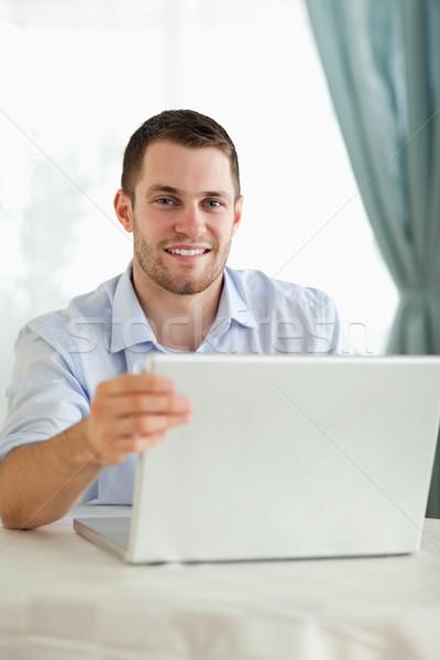 Gülen işadamı dizüstü bilgisayar arkasında büro iş Stok fotoğraf © wavebreak_media