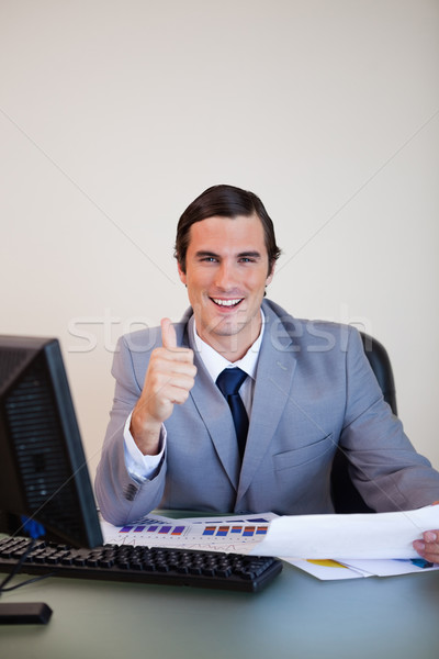 Smiling businessman approving statistics Stock photo © wavebreak_media