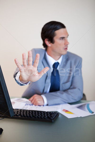 Hand used by businessman to reject something Stock photo © wavebreak_media