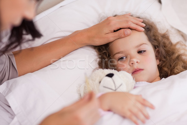 Young mother taking care of her ill daughter Stock photo © wavebreak_media
