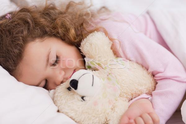 Kislány ölel plüssmaci alszik gyermek otthon Stock fotó © wavebreak_media