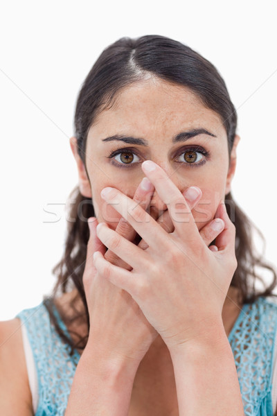 Portrait of a woman hiding her mouth against a white background Stock photo © wavebreak_media