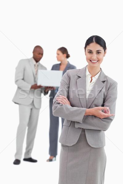 Elarusítónő beszél kollégák mögött fehér üzlet Stock fotó © wavebreak_media