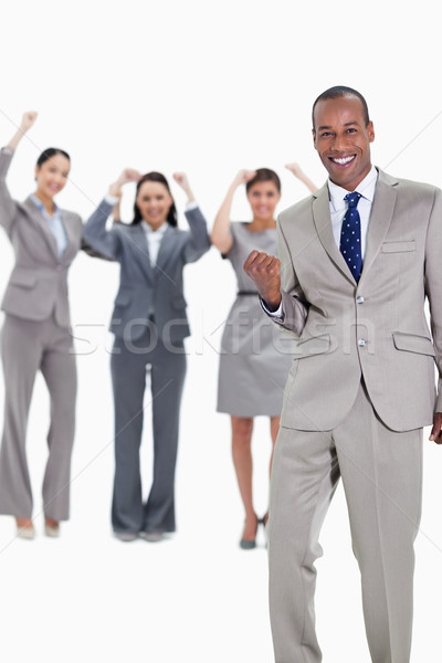 Successful business team with a happy businessman in foreground and three enthusiastic co-workers ra Stock photo © wavebreak_media
