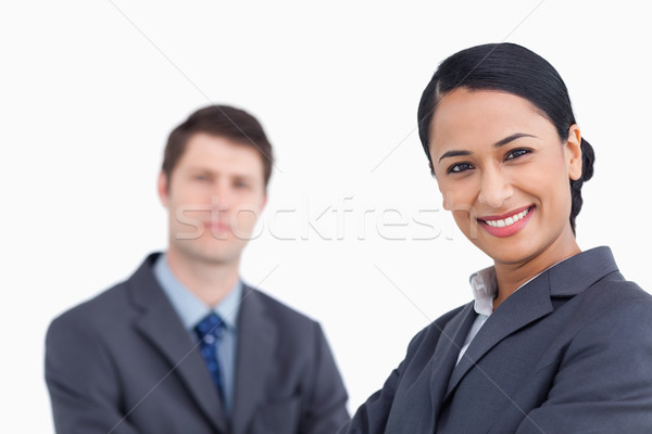 Close up of smiling saleswoman with co-worker behind her against a white background Stock photo © wavebreak_media