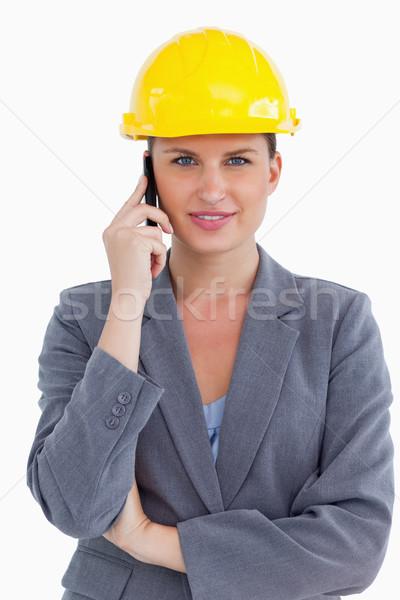 Smiling female architect on her cellphone against a white background Stock photo © wavebreak_media