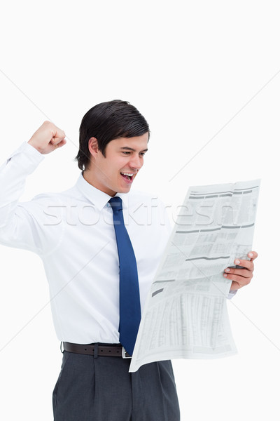 Celebrating tradesman looking at the news against a white background Stock photo © wavebreak_media