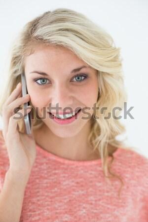 Sorridente mulher loira branco moda fundo Foto stock © wavebreak_media