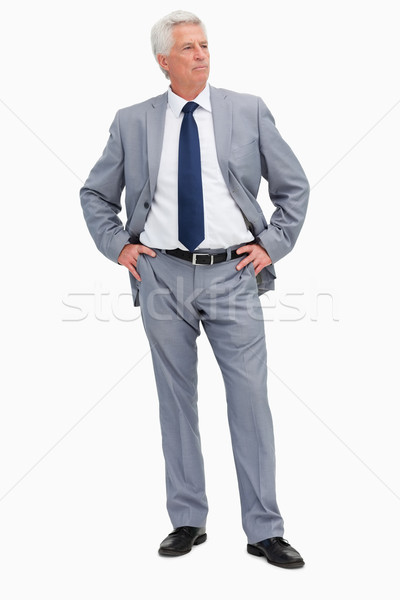 Businessman with her hands on her hips against white babckground Stock photo © wavebreak_media