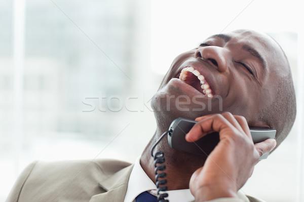 Közelkép elragadtatott üzletember telefon iroda üzlet Stock fotó © wavebreak_media