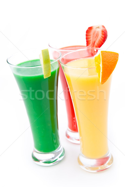 Full glasses with fruits pieces against white background Stock photo © wavebreak_media