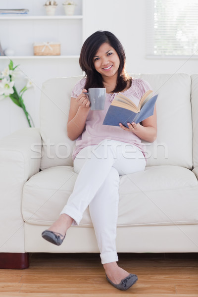 Woman smiling and reading a book Stock photo © wavebreak_media