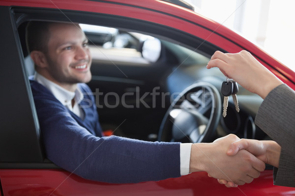 Client shaking hand to a woman in a garage Stock photo © wavebreak_media
