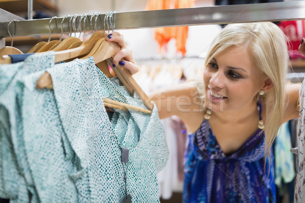 Woman  standing at the clothes rack smiling  Stock photo © wavebreak_media