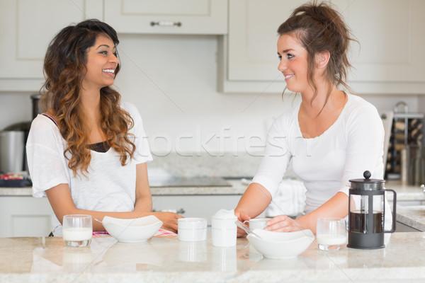 Two friends enjoying breakfast together in kitchen Stock photo © wavebreak_media