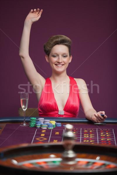 Femme célébrer roulette casino argent Homme Photo stock © wavebreak_media