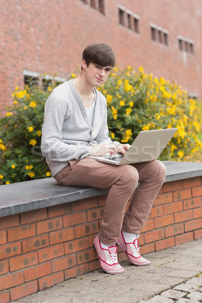 öğrenci oturma duvar dizüstü bilgisayar bilgisayar Stok fotoğraf © wavebreak_media