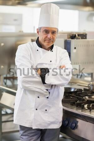 Szakács mosolyog áll tűzhely konyha boldog Stock fotó © wavebreak_media