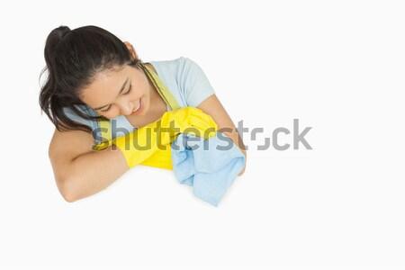 Lächelnde Frau Gummihandschuhe Schürze schauen weiß Oberfläche Stock foto © wavebreak_media