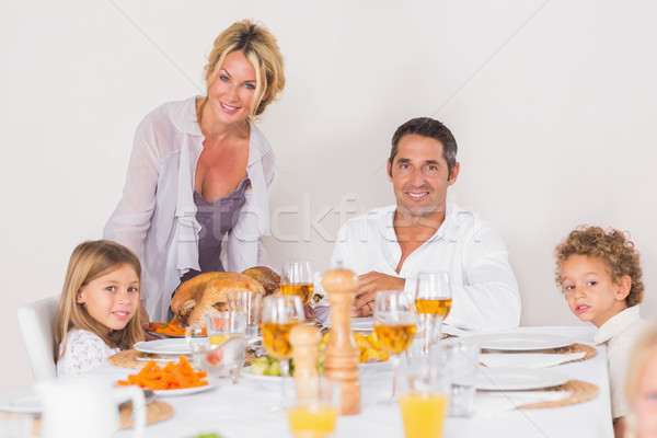 Mother putting a turkey on the table Stock photo © wavebreak_media