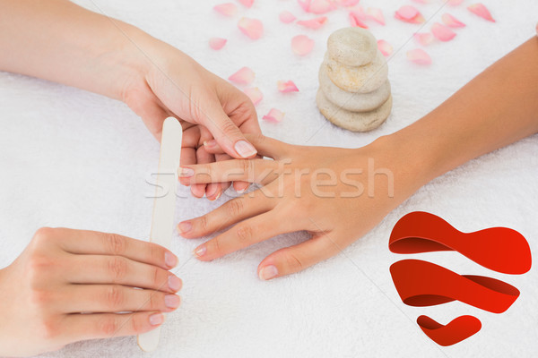 Composite image of nail technician filing customers nails Stock photo © wavebreak_media