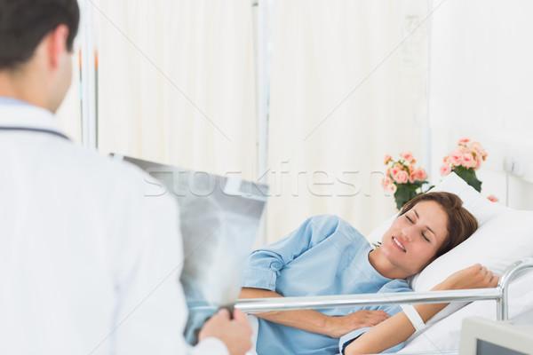 Doctor visiting patient in the hospital Stock photo © wavebreak_media