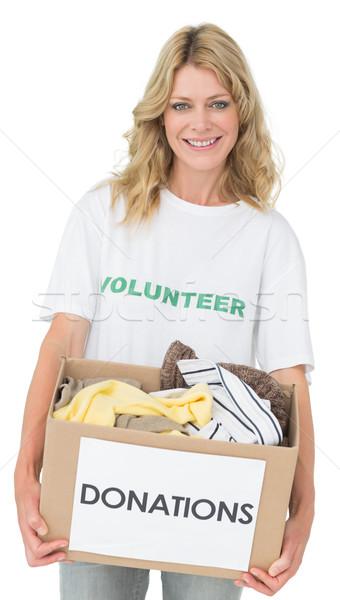 Portret uśmiechnięty młoda kobieta ubrania darowizna biały Zdjęcia stock © wavebreak_media