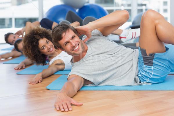 People doing pilate exercises in fitness studio Stock photo © wavebreak_media