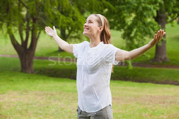 Smiling woman with arms outstretched at park Stock photo © wavebreak_media