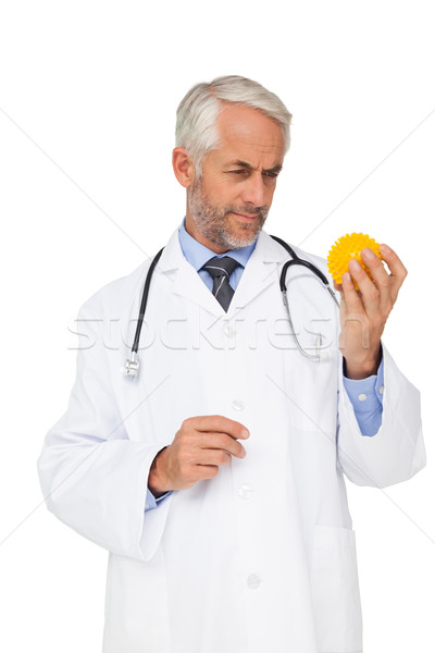 Concentrated male doctor looking at stress ball Stock photo © wavebreak_media