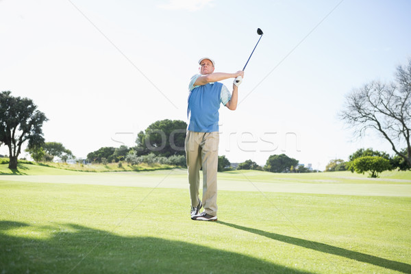 Concentrating golfer taking a shot Stock photo © wavebreak_media