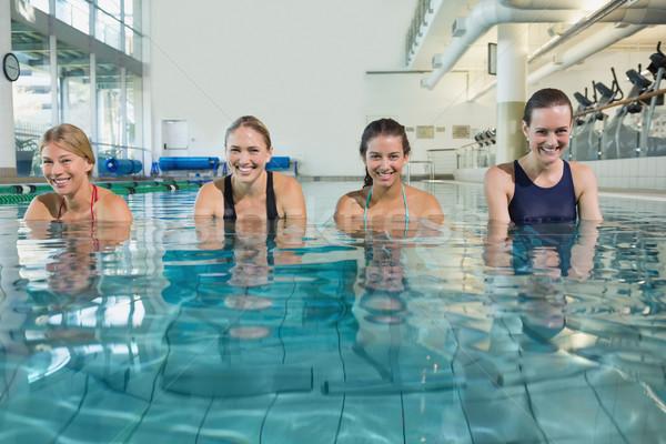 Kadın uygunluk sınıf su aerobik yüzme havuzu Stok fotoğraf © wavebreak_media
