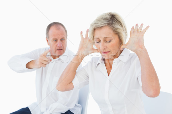 Older couple sitting in chairs arguing Stock photo © wavebreak_media