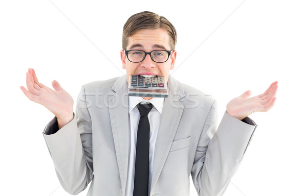 Geeky shrugging businessman biting calculator Stock photo © wavebreak_media
