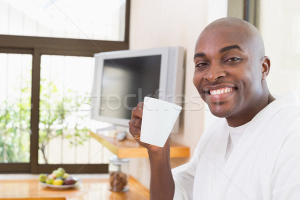 счастливым человека халат питьевой кофе домой Сток-фото © wavebreak_media