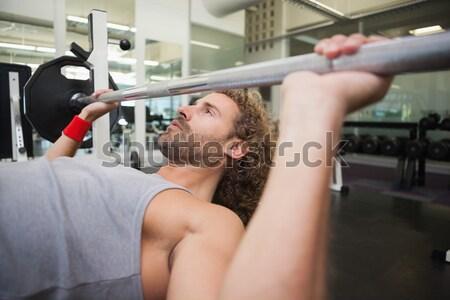 Sem camisa muscular homem barbell ginásio Foto stock © wavebreak_media