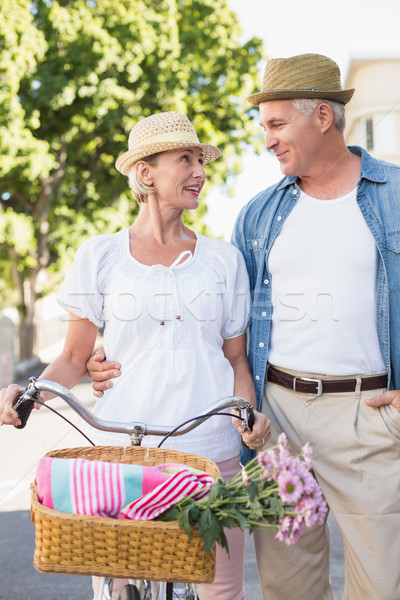 Stock photo: Happy mature couple going for a bike ride in the city