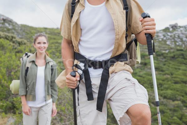 Caminhadas casal caminhada montanha terreno retrato Foto stock © wavebreak_media