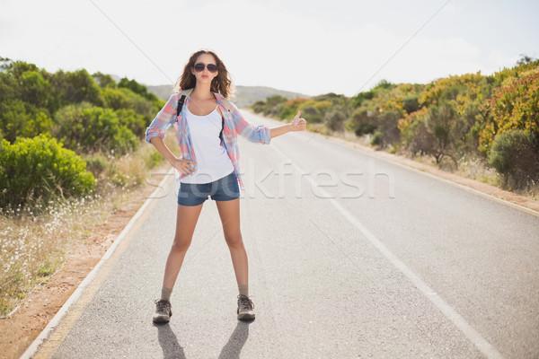 Woman hitchhiking on countryside road Stock photo © wavebreak_media