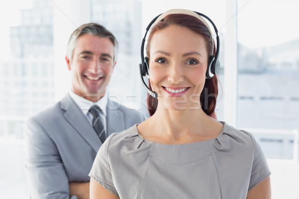Businesswoman wearing a work headset Stock photo © wavebreak_media